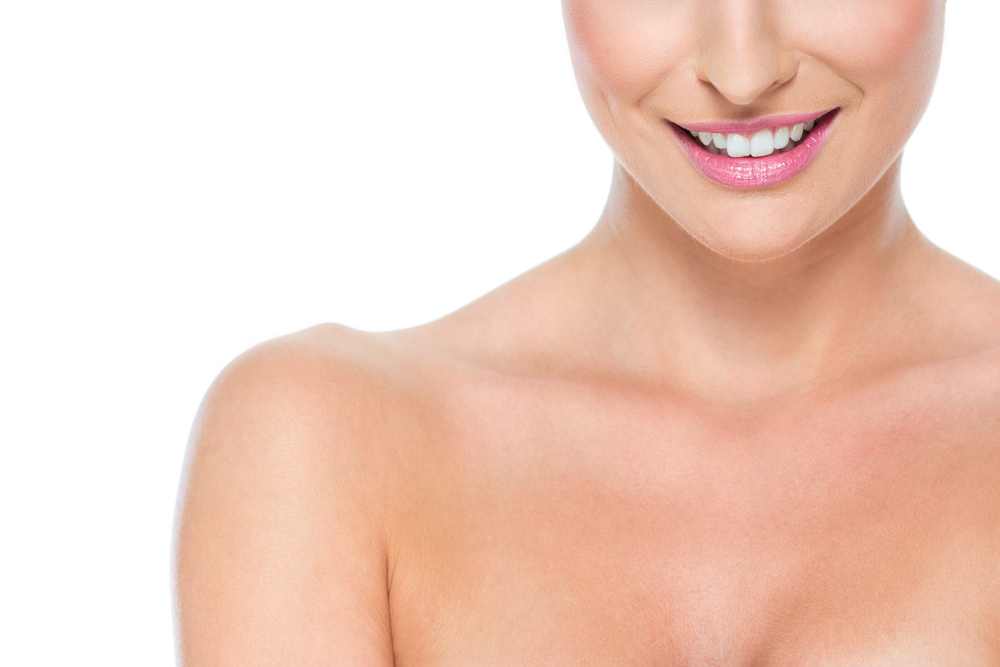 woman smiling with shoulders showing decolletage area